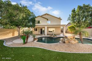 Backyard features a large pool and plenty of room for hosting!