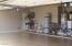 3 car garage with epoxy coat flooring