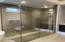 Custom glasswork shower surround with barn door opening