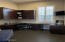 Office with built-in cabinets. Currently being used as children's study/gaming area.