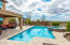 Pool & spa surrounded by travertine deck