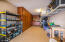 40' deep x 10' wide 3rd/4th bay (tandem) garage! Built-in cabinets.