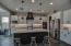 kitchen island, breakfast bar, canned lights, custom stove hood, coffee bar