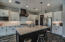 Chefs kitchen with upgraded cabinets, fixtures, pulls, and lighting, walk in pantry, built in microwave and double oven