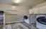 Large laundry room with built in cabinets