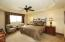 Master bedroom with golf course views and private balcony