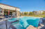 Gorgeous pool area outfitted with Wolf appliances, massive indoor kitchen, and plenty of room to entertain.