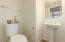 Half bath off family room.