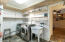 Huge laundry room with built in shelving
