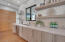 This chef's kitchen provides not only great counter space for your creations but two dishwashers and sinks for easy clean-up, as well