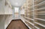 One of two walk-in closets in the this spectacular primary bedroom