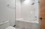 Kohler fixtures complete this modern soaking tub/shower.