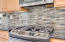 And look at this high end gas range/oven and that beautiful mosaic tile backsplash! You are going to love cooking on this!