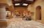 Hallway with dramatic ceiling