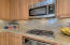Upgraded designer cabinetry, Jenn Air stainless steel appliances, gas cooktop!