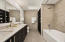 """Gorgeous """"leathered"""" granite vanity tops and double sinks as well."""