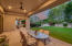 The covered patio runs the entire length of the home and is cooled by brand new ceiling fans.