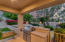 Directly off of the kitchen/dining area is a built-in BBQ/kitchen complete with bar seating.