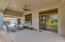 Extra-wide arcadia doors lead from the formal dining area to the patio, and a picture window offers unobstructed views from the formal living room.