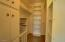 BIG Walk-in Closet with lots of shelves/cabinets/storage space!