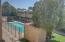 View from Living Room window to Community Pool and Greenbelt