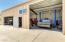 Lift conveys. Oversized roll-up garage door. Double garage door with remote.