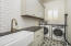 Spacious Laundry Room With Farm Sink & Artisan Tile