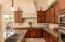 Large Cabinet and Granite Top area with Sink in Island