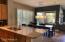 Kitchen overlooks breakfast and family room