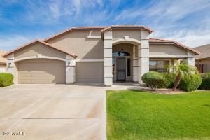 Welcome home to this Adobe Highlands 4 bedroom 2.5 bath home with a pebble tec pool and 3 car garage.