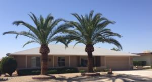 "The curb appeal with the 2 stately date palms is a ""10"""