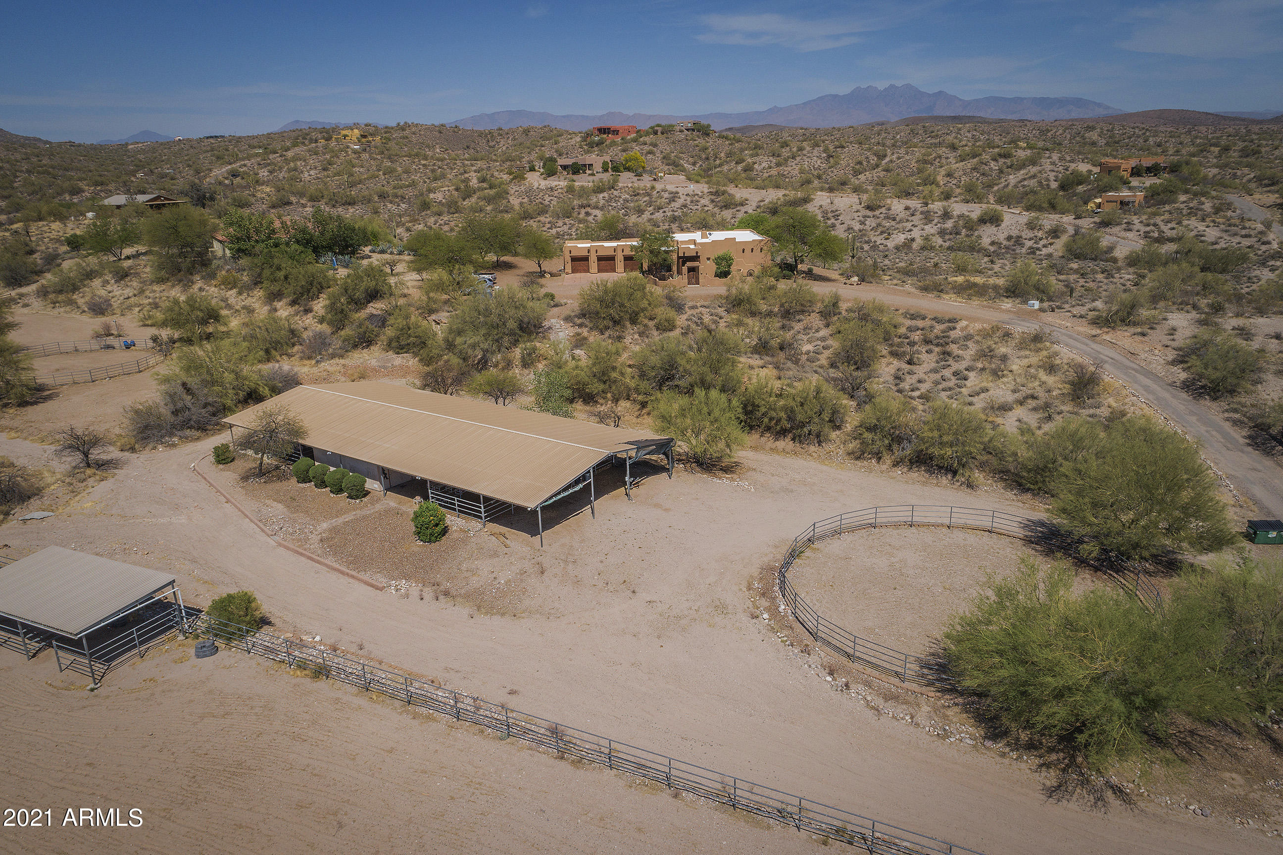 5+ Acres!!! Bring your Horses, Toys and RV's. Beautiful Territorial Style home nested into the foothills of Goldfield Ranch. Some of the best views in the Valley. Gorgeous Open floor Plan with floor to ceiling glass showcasing the amazing mountain views. Custom Chocolate Saltillo flooring, Custom Wood touches throughout the home, Oversized, Insulated 3 Car Garage, Best horse set up around , 4860 aprox sq ft Barn with stalls, Automatic Waters, Lighting, Tack Room or storage Room, 2 Wash racks, Grooming stations and more. Endless possibilities!!! Turn out area with 2 separate shades, tie post, Arena 280X180 and Fabulous 60' Foot Round Pen. Just minutes from Fountain Hills Bring your Toys, RV's plenty of room on this gorgeous horse property. Private Well!!!!