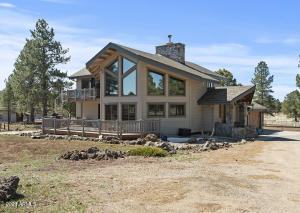 East side of home is a chalet style with lots of window to enjoy the views.