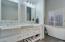 Sleek and modern bath! Dual vanity and designer fixtures with incredible soaking tub!