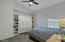 Another large bedroom where no one needs to worry about who gets the better room! Amazing built in shelving, generous closet space and amazing shutters and vaulted ceilings