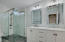 Beautifully updated upstairs bath with dual sinks and glass enclosed spa experience shower!