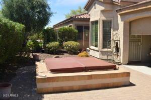Spa and backyard area