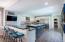 Porcelain tile, quartz countertops, under cabinet lighting, perfect for entertaining.