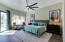 Large master bedroom with power shade screens & private pool access.
