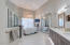 This master bathroom! Under-lit cabinetry, wall tile that takes it over the top!