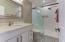 Beautiful brand new bathroom with quartz counters and gorgeous deco tile.