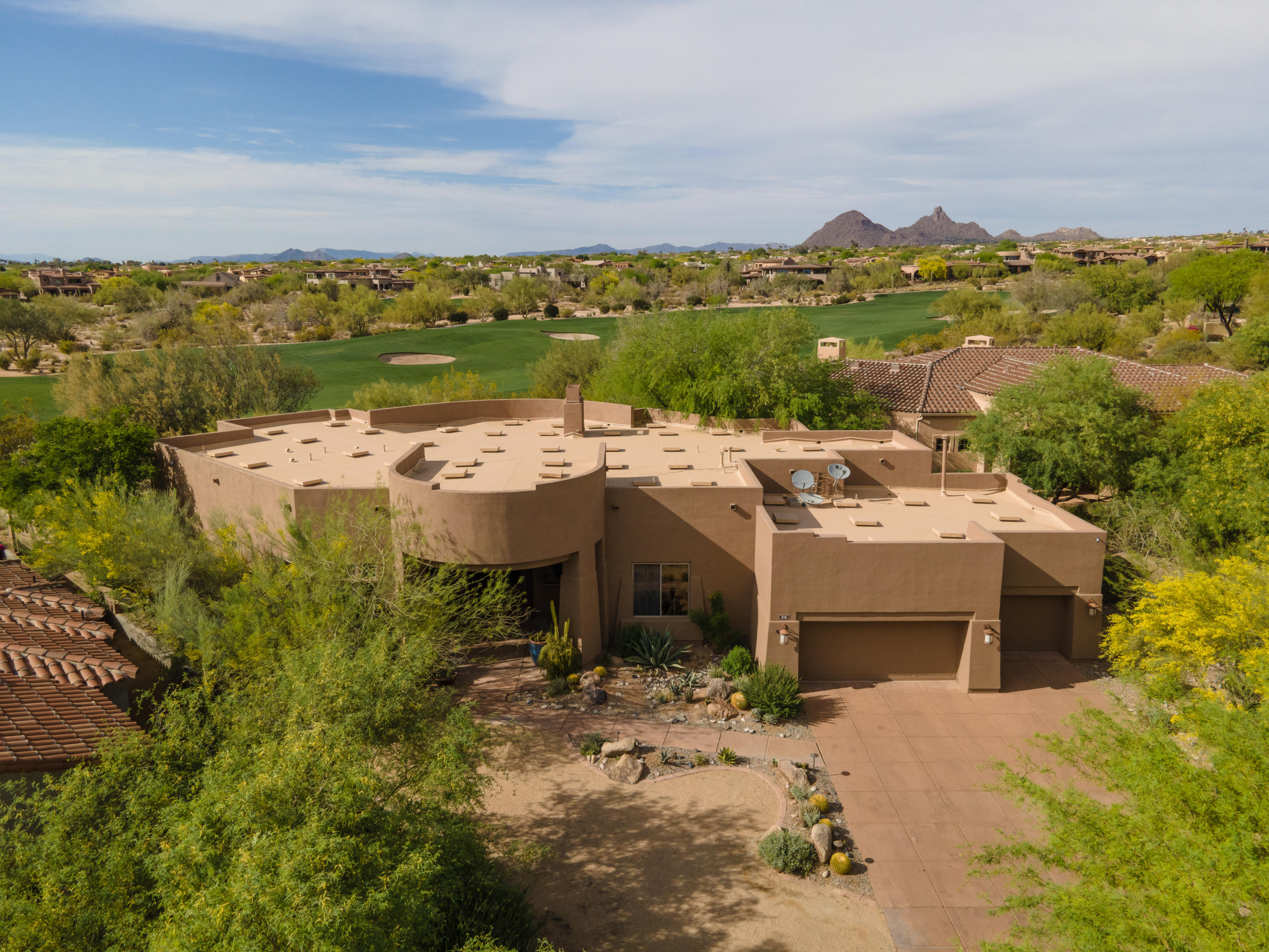 Spectacular golf course lot in prestigious DC Ranch Country Club! This beautiful home sits  on the 4th hole with gorgeous mountain views. Ideal floor plan with spacious master split, home office or work out room and 2 guest rooms with en-suite baths. Great room w/ gourmet eat-in kitchen, large island with seating, and 100 bottle wine fridge. Formal living, dining room and wet bar. All living areas and master open to the low maintenance backyard which is an entertainer's dream. Huge flagstone covered patio, pebble tec heated pool and elevated spa. Built in BBQ w/ bar seating, and cozy fire pit for those brisk winter nights.  Perfect lock and leave opportunity w/ turf and natural desert landscaping. Walking paths to Country Club & DC Ranch Marketplace. Floorplan in documents.