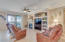 Great room with built in cabinetry and fireplace