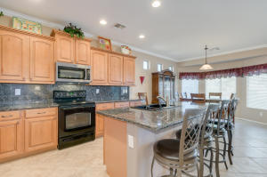 Beautiful gourmet kitchen with granite countertops and backsplash
