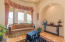 Architectural Details include Dramatic Arches and Tray Ceiling