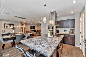 Designer kitchen with beautiful pendant lights, upgraded stainless steel appliances and granite counters!
