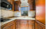 Finely Finished Slab Granite Countertop, Cherrywood Cabinets