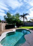 Sparkling pool, large covered patio with misting system and lovely lake views...