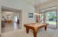 Formal dining/living room opens to the kitchen/great room for easy traffic flow.
