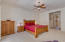 This picture shows room for a king size bed, two nightstands, and a highboy dresser.